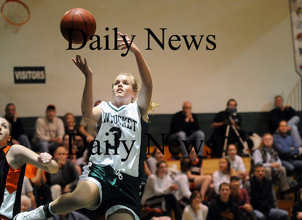 West Newbury: Emily Lane (3) of Pentucket throws up a lay up after stealing the ball from an Ipswich opponent during Tuesday nights game in West Newbury. Photo by Ben Laing/Newburyport Daily News Tuesday January 20, 2009.