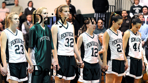 West Newbury: The Pentucket girls basketball team stands during the playing of the National Anthem at Tuesday night's game against Ipswich in West Newbury. Photo by Ben Laing/Newburyport Daily News Tuesday January 20, 2009.