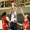 West Newbury: Pentucket's Kirsten Daamen shoots over two Masconomet defenders during Friday nights game in West Newbury. Photo by Ben Laing/Newburyport Daily News  Friday January 16, 2009.