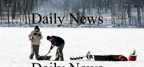Newburyport: A couple of ice fishermen venture out on the Artichoke Monday afternoon in Newburyport to try their luck, despite the cold temperatures. Photo by Ben Laing/Newburyport Daily News Monday January 26, 2009.