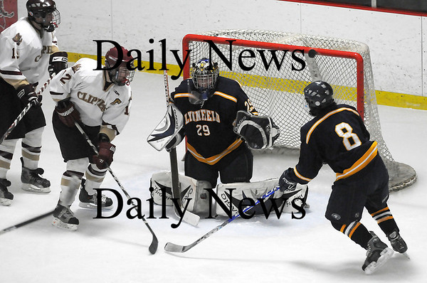 Newburyport: Newburyport had their fair share of scoring oppurtunities during Saturday night's game against Lynnfield, perhaps none closer than this shot that went off the crossbar late in the third period with the Clippers trailing 2-1. Photo by Ben Laing/Newburyport Daily News Saturday January 31, 2009.