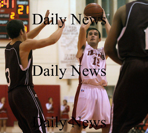 Amesbury: Amesbury captain Billy Medvitz takes a shot during Monday night's game against Rockport at AHS. Photo by Ben Laing/Newburyport Daily News Monday January 12, 2009.