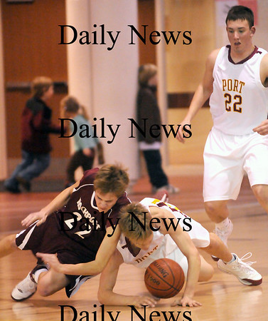 Newburyport: Newburyport's Kyle Uhlig (10) dives for a loose ball after knocking it loose from Rockport's Michael Akers (22) during last night's game at NHS. Photo by Ben Laing/Newburyport Daily News Wednesday January 7, 2009.