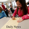 Newbury: Cameron Dacy, a first grader at Newbury Elementary, works on a portrait of a clown during Mrs. Merluzzi's art class Tuesday. Photo by Ben Laing/Newburyport Daily News Tuesday January 20, 2009.