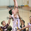Newburyport: Newburyport's Nick Welch (22) jumps through a forrest of outstreched arms as Rockport took on the Clippers at NHS. Photo by Ben Laing/Newburyport Daily News Wednesday January 7, 2009.