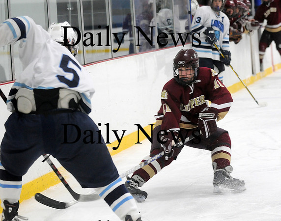 Newburyport: Ryan Cutter (11) of Newburyport challenges Wilmington's Dan Cushing (5) for the puck during the Clippers 4-2 win on Wednesday. Photo by Ben Laing/Newburyport Daily News Tuesday January 21, 2009.
