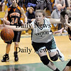 West Newbury: Pentucket's Kirsten Daamen (32) stretches to save the ball from going out of bounds during Tuesday night's game against Ipswich at West Newbury. Photo by Ben Laing/Newburyport Daily News Tuesday January 20, 2009.