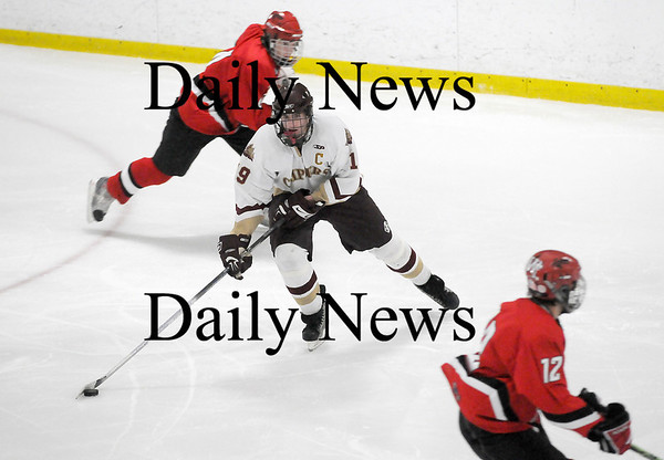 Newburyport: Clipper captain Kevin Holmes (19) weaves through the Amesbury defense during last night's game at the Graf Rink. Newburyport won 3-1. Photo by Ben Laing/Newburyport Daily News Wednesday January 14, 2009.