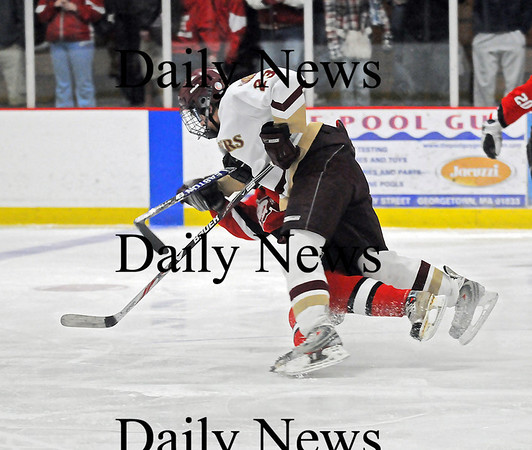 Newburyport: Newburyport's Gregory Schofield (23) levels an Amesbury opponent at mid-ice during last nights 3-1 win at the Graf Rink. Photo by Ben Laing/Newburyport Daily News Wednesday January 14, 2009.