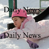Newburyport: Kyla Prussman, 5, of Rowley, goes head first down the slide at the Tot Lot on Inn Street in Newburyport Friday, the snow bank at the bottom cushioning her landing. Photo by Ben Laing/Newburyport Daily News Friday January 30, 2009.