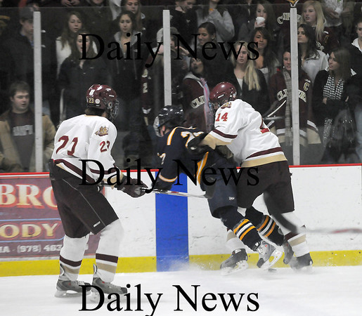 Newburyport: Senior defenseman Dave Freeman (14) of Newburyport lays out Lynnfield's Dylan Costa (22) right in front of the Clipper faithful at Saturday nights 2-2 tie at the Graf Rink. Photo by Ben Laing/Newburyport Daily News Saturday January 31, 2009.