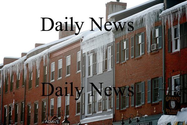 Newburyport: Icicles stretch down from the rooftops along State Street, creating a potential hazard for pedestrians below. Photo by Ben Laing/Newburyport Daily News Tuesday January 20, 2009.