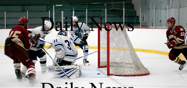 Wilmington: Wilmington's goalie, Zachary Rosa (31), looks for the puck as it slides through his legs. The puck sat just outside the goal before being knocked in by Newburyport's Kevin Holmes. Photo by Ben Laing/Newburyport Daily News Tuesday January 21, 2009.
