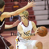 Newburyport: The Clippers Kyle Uhlig (10) looks for an open teammate as Newburyport battled Rockport at Newburyport High School Wednesday night. Photo by Ben Laing/Newburyport Daily News Wednesday January 7, 2009.
