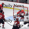 Newburyport: Derek Freeman (8) of Newburyport just misses the net after scooping up a rebound in front of Amesbury net minder, Matthew Irwin (30). Photo by Ben Laing/Newburyport Daily News Wednesday January 14, 2009.