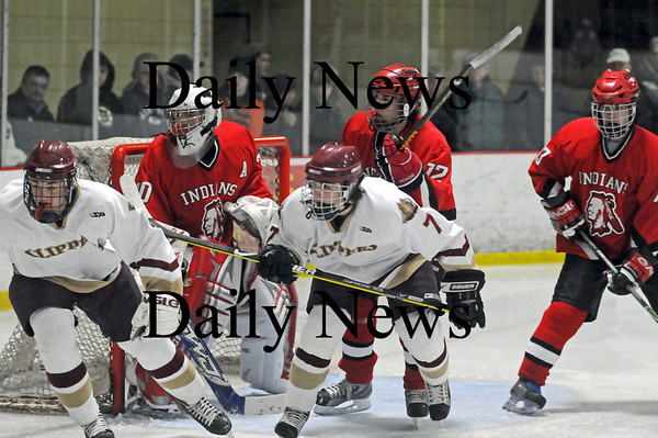 Newburyport: The Indians defense had their work cut out for them as the forwards for Newburyport kept the pressure on Amesbury goalie Matt Irwin (30). The Clippers won by a score of 3-1. Photo by Ben Laing/Newburyport Daily News Wednesday January 14, 2009.