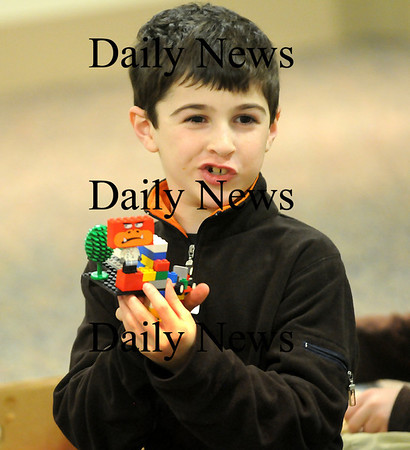 Georgetown: Owen Birmingham of Georgetown shows off his creation at the Lego Club at the Georgetown Peabody Library Wednesday night. Photo by Ben Laing/Newburyport Daily News Tuesday January 21, 2009.