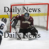 Newburyport: Chris Eiserman (1) turns away a point blank shot by Triton's Carson True (6). Eiserman's shut out lead the way for the Clippers 6-0 victory. Photo by Ben Laing/Newburyport Daily News Saturday January 17, 2009.