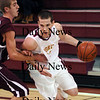 Newburyport: Joe Clancy (11) drives to the basket on a Rockport defender as Newburyport hosted the Vikings at NHS Wednesday night. Photo by Ben Laing/Newburyport Daily News Wednesday January 7, 2009.