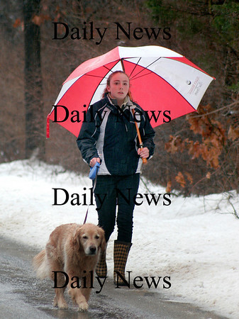 Newbury: The foul weather didn't keep Allie Murray from taking Gino the golden retriever for his daily walk along Hay Street in Newbury Wednesday. Photo by Ben Laing/Newburyport Daily News Wednesday January 7, 2009.