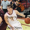 Newburyport: Newburyport's Joe Clancy (11) drives to the basket as the Clippers took on Rockport at Newburyport High Wednesday night.Photo by Ben Laing/Newburyport Daily News Wednesday January 7, 2009.