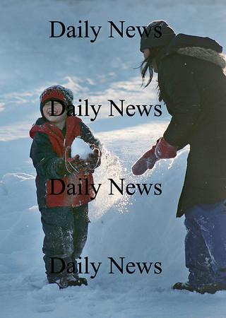 Newbury: Lukas Carmona and his nanny, Paloma Ibarra, have themselves a snowball fight on the ice at the Upper Green in Newbury Monday afternoon. Photo by Ben Laing/Newburyport Daily News Monday January 12, 2009.