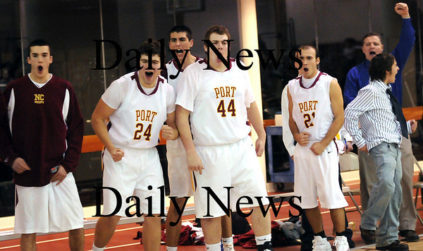 Newburyport: The Clipper's bench explodes in cheers after Nick Welch goes to the line for a 3-point-play late in the fourth quarter in Wednesday's game against Rockport. Photo by Ben Laing/Newburyport Daily News Wednesday January 7, 2009.