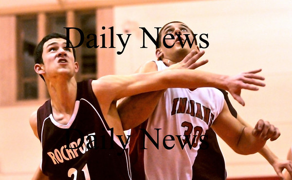 Amesbury: Amesbury's Steve Serwon (30) boxes out Rockport's Kevin Corrigan (21) during Monday nights game at AHS. Photo by Ben Laing/Newburyport Daily News Monday January 12, 2009.