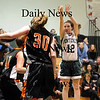 West Newbury: Pentucket's Erin McNamara (12) takes a jump shot over Ipswich's Amber Smith (30) during Tuesday nights game in West Newbury. Photo by Ben Laing/Newburyport Daily News Tuesday January 20, 2009.