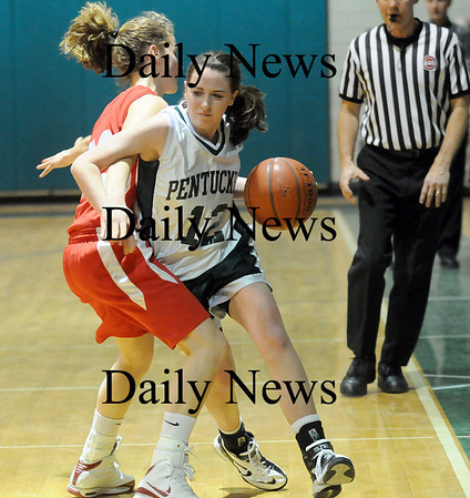 West Newbury: Erin McNamara (12) of Pentucket tries to squeeze past a Masconomet defender during Friday nights game in West Newbury. Photo by Ben Laing/Newburyport Daily News  Friday January 16, 2009.