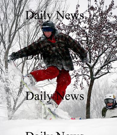 Newburyport: Parker Szumowski of Newburyport enjoys his snow day Wednesday by snowboarding at the Bartlett Mall with his friends. Photo by Ben Laing/Newburyport Daily News Wednesday January 28, 2009.