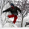 Newburyport: Parker Szumowski of Newburyport enjoys his snow day Wednesday by snowboarding at the Bartlett Mall with his friends. Photo by Ben Laing/Newburyport Daily News Wednesday January 28, 2009.