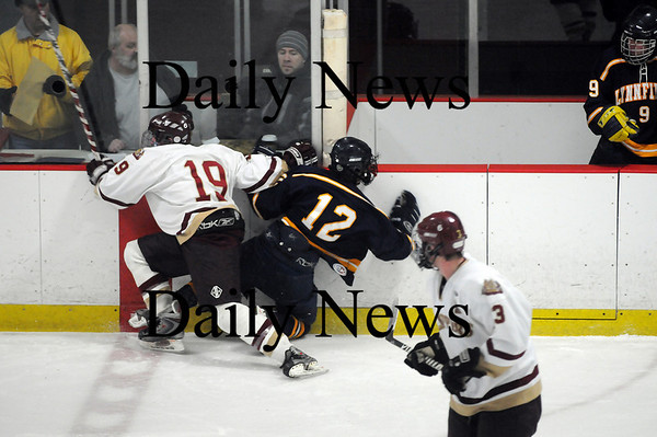 Newburyport: Lynnfield's Cam Higgins (12) gets a face full of boards after Newburyport's Kevin Holmes (19) lays a big check on him during Saturday nights game at the Graf Rink. Photo by Ben Laing/Newburyport Daily News Saturday January 31, 2009.