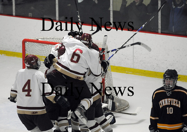 Newburyport: The Clippers celebrate after Kyle McElroy put home the tying goal with under 30 seconds to play as Newburyport and Lynnfield skated away with a hard fought, 2-2 tie. Photo by Ben Laing/Newburyport Daily News Saturday January 31, 2009.