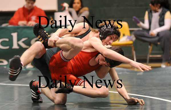 West Newbury: Pentucket's Brandon Haley tries to take down Melrose's Frankie Kelly during Wednesday's wrestling match in West Newbury. Photo by Ben Laing/Newburyport Daily News Tuesday January 21, 2009.