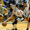 West Newbury: Kirsten Daamen (32) of Pentucket puts the ball on the floor as she moves to the basket against an Ipswich defender during Tuesday nights game at West Newbury. Photo by Ben Laing/Newburyport Daily News Tuesday January 20, 2009.