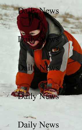 Amesbury:<br /> Mike Gwynn, 6, of Amesbury is bundled up against the cold as he climbs back up the hill at Woodsom Farm in Amesbury for another sled run.<br /> Photo by Bryan Eaton/Newburyport Daily News Friday, January 02, 2009