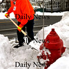 Newburyport:<br /> Kevin Kozuchowski of Newburyport's Department of Public Services cleans out a fire hyrdrant on High Street at Coffin's Court on Tuesday afternoon. Crews will be out this week as more snow is forecast along with biting cold.<br /> Photo by Bryan Eaton/Newburyport Daily News Tuesday, January 13, 2009
