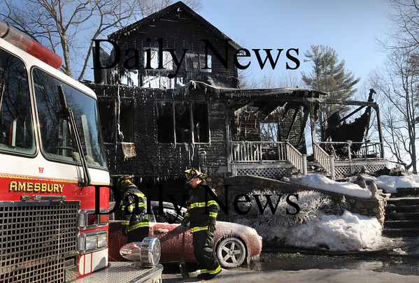 Amesbury:<br /> A single family home was destroyed by fire early Monday morning on Birch Meadow Road in Amesbury on Lake Attitash. Firefighters had a tough battle fighting the fire in extreme cold and dealing with problems getting water to the scene.<br /> Photo by Bryan Eaton/Newburyport Daily News Monday, January 26, 2009