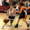 Newburyport:<br /> Newburyport's Caitlin Hill moves down court past an Ipswich player last night at Newburypor High School.<br /> Photo by Bryan Eaton/Newburyport Daily News Friday, January 23, 2009