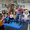 Newburyport:<br /> Kindergartners in Sherry Herzig's class at the Brown School in Newburyport take turns jumping up as the letter their wearing is sung from Chicka Chicka Boom Boom. The students are working on a skit from work that helps them out learning the alphabet.<br /> Photo by Bryan Eaton/Newburyport Daily News Thursday, January 22, 2009