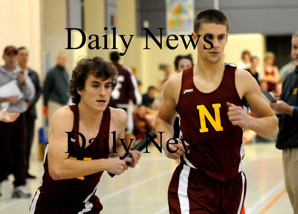 Ipswich:<br /> Newburyport's Tom Svirsky, left, takes the baton from Kyle LeBlanc in the relay mile run in Ipswich.<br /> Photo by Bryan Eaton/Newburyport Daily News Tuesday, January 06, 2009