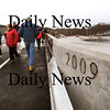Newbury:<br /> The date of completion of the new Route 1A bridge over the Parker River in Newbury is stamped onto both ends as citizens crossed over the bridge yesterday after a short ceremony.<br /> Photo by Bryan Eaton/Newburyport Daily News Monday, January 05, 2009