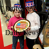 Amesbury:<br /> Suzanne Morin's class at Amesbury Elementary School went all out with the inauguration of President Obama including laying out a red carpet and doing a mock ceremony. The students then got a piece of a giant Obama cookie which Sophia Haritas, left, and Christopher Chabot, both 8, are showing off.<br /> Photo by Bryan Eaton/Newburyport Daily News Tuesday, January 20, 2009