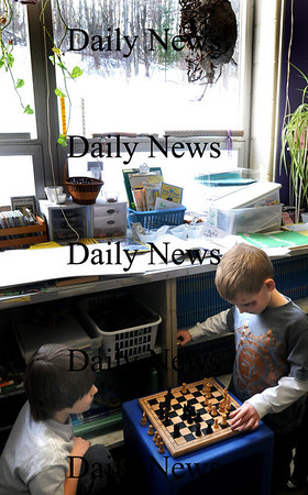 Amesbury:<br /> With snow outside the window and blowing tree limbs, Blair Bourassa, 8, left, plays a game of chess with Connor Gannon, 7, in Liz Morris' class at Amesbury Elementary School. They had indoor recess Wednesday due to the cold weather.<br /> Photo by Bryan Eaton/Newburyport Daily News Wednesday, January 14, 2009