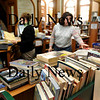 Amesbury:<br /> Sarah Seamans, library assistant, left, and Laurie Pierce, administrative assistant at the Amesbury Public Library process a heavy volume of books, cd's and dvd's to be restocked. The library is currently down two positions that won't be filled until further notice.<br /> Photo by Bryan Eaton/Newburyport Daily News Thursday, January 22, 2009