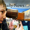 Newbury:<br /> David Durante, 8, looks through a stereoscope of old pictures of Newbury including the Spencer-Peirce-LIttle Farm owned by Historic New England. Staff members were at Newbury Elementary School on Tuesday teaching children about life in the 1800's.<br /> Photo by Bryan Eaton/Newburyport Daily News Tuesday, January 27, 2009
