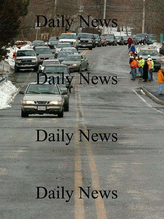 Newbury:<br /> Newbury Assistant Harbormaster Terry O'Malley is first in the line of traffic to head south over the Route 1A Bridge in Newbury after MassHighway workers removed the barriers yesterday afternoon.<br /> Photo by Bryan Eaton/Newburyport Daily News Monday, January 05, 2009