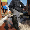 "Newburyport: Letter carrier Bill Tremblay uses ""stabilizers"" on the bottom his boots to walk the icy streets and sidewalks of Newburyport's downtown area. The strap-on device have small cleats attached which help to create traction as golf or football cleats. Photo by Bryan Eaton/ Newburyport Daily News   Thursday January 29, 2008."