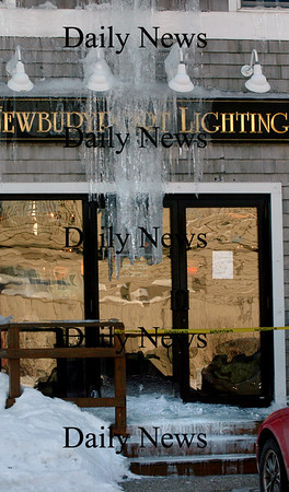 Newburyport:<br /> Huge icicles hang in front a the main entrance to Newburyport Lighting, opposite the Black Cow restaurant, making it necessary for customers to go in a side door. Breaking the ice up wouldn't help as a thick coating of ice is on the steps making a slippery condition.<br /> Photo by Bryan Eaton/Newburyport Daily News Tuesday, January 27, 2009